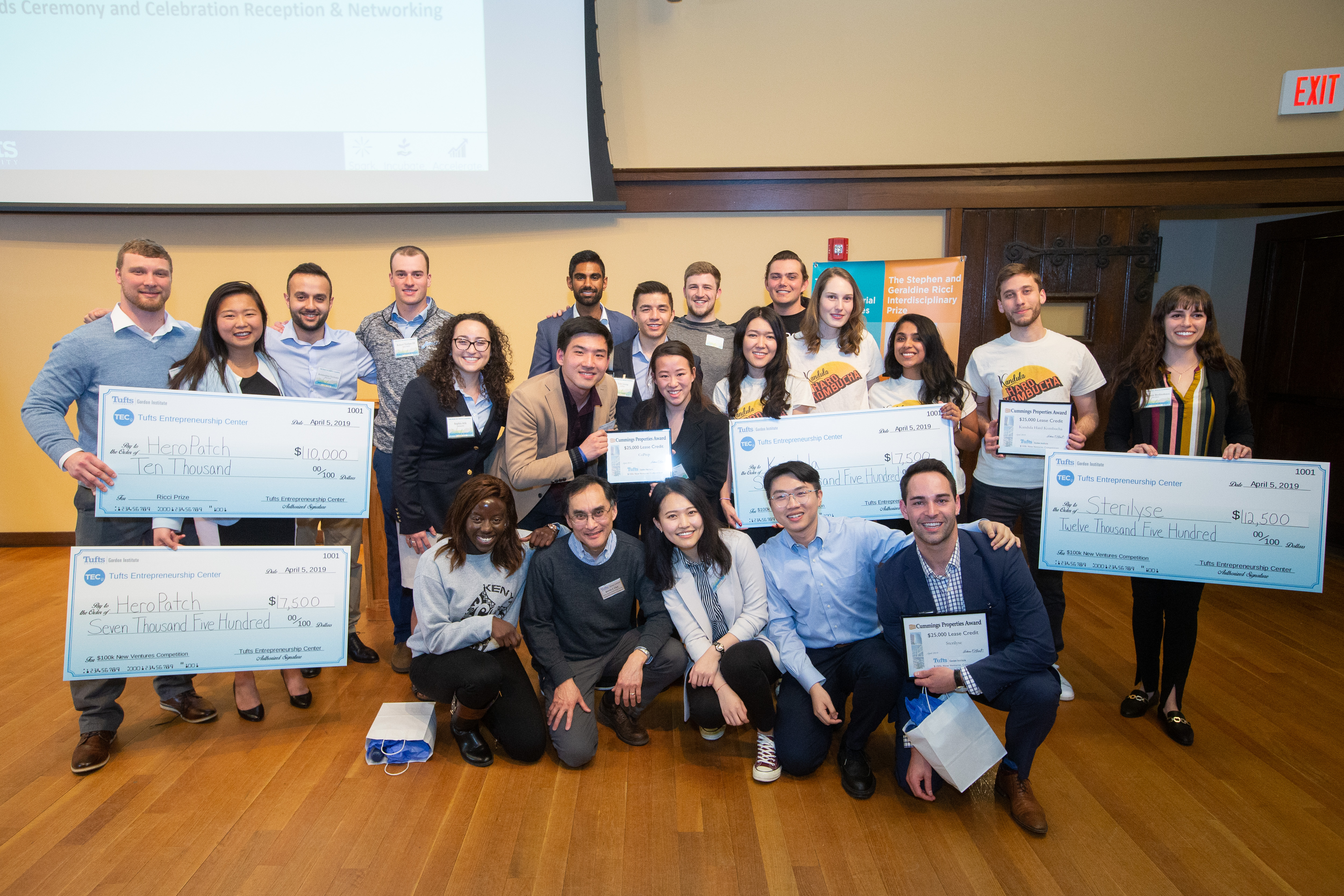 Photo of MSIM Winners in the 2019 Tufts $100k New Ventures Competition holding large checks