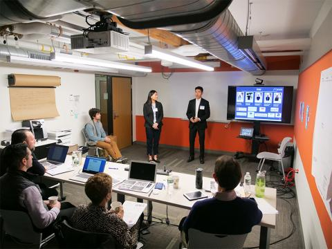 Catherine Jiang and Lin Htet Kyaw from Team Acadia present their venture to judges.