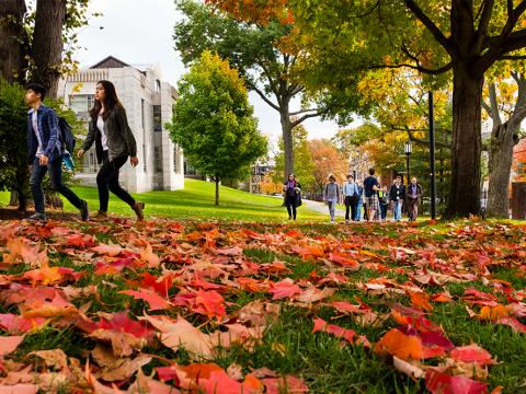 Tufts University campus in fall with foliage on the ground.